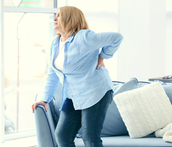 Senior woman suffering from backache