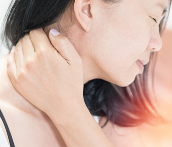Female hand on her neck as suffering from neck ache