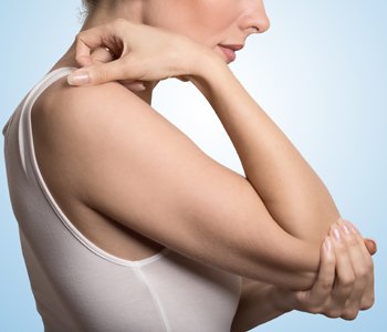 Woman with painful elbow